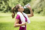 Athletic young woman drinking bottled water