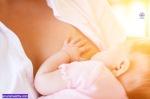 Mother nursing baby by breastfeeding